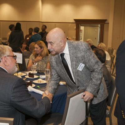 SC Humanities Board Member Will Balk greets Scott Gwara (2019 Fresh Voice)